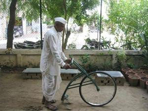 Bicycle re-purposed as weeder/hoe