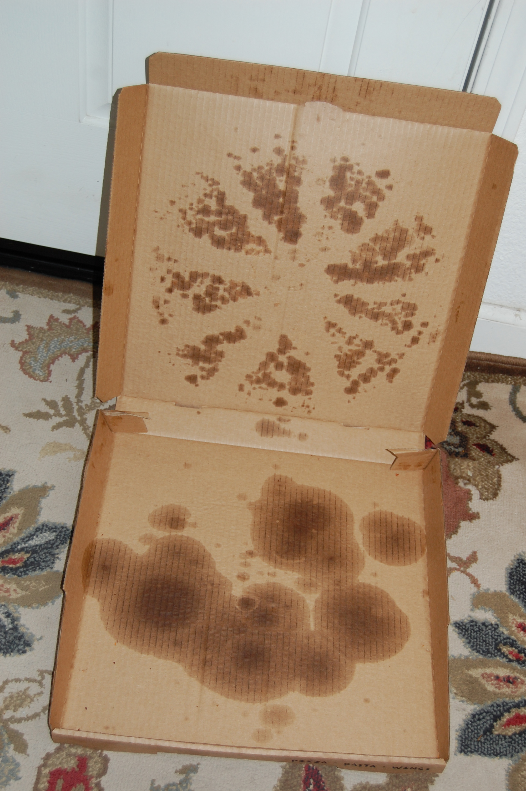 Greasy Pizza Box goes in the trash - What a waste of paper / cardboard!