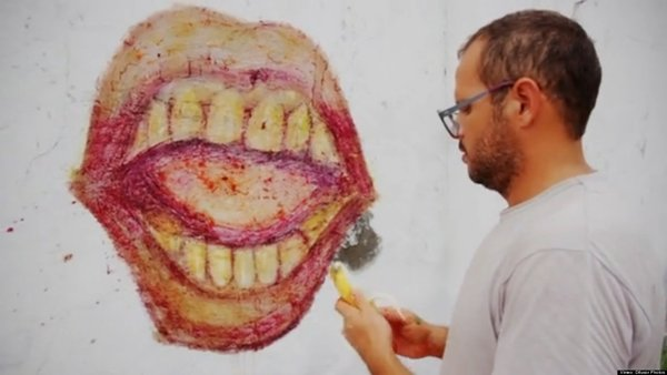 WATCH: Artist Creates Graffiti With Discarded Food