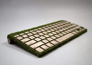 Natural computer keyboard made of wood and moss