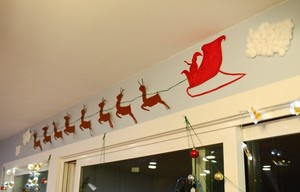Santa and his reindeer flying up in the sky