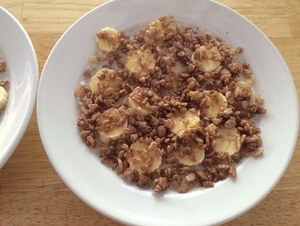 Oatmeal topped with banana and chocolate rice krispies