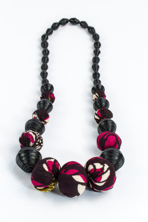 Handmade necklace by @songadesigns  using recycled paper and local fabric
