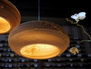 Beautiful lampshades made from salvaged pieces of corrugated cardboard.