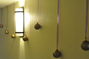 Old christmas ornaments used as wall hangings