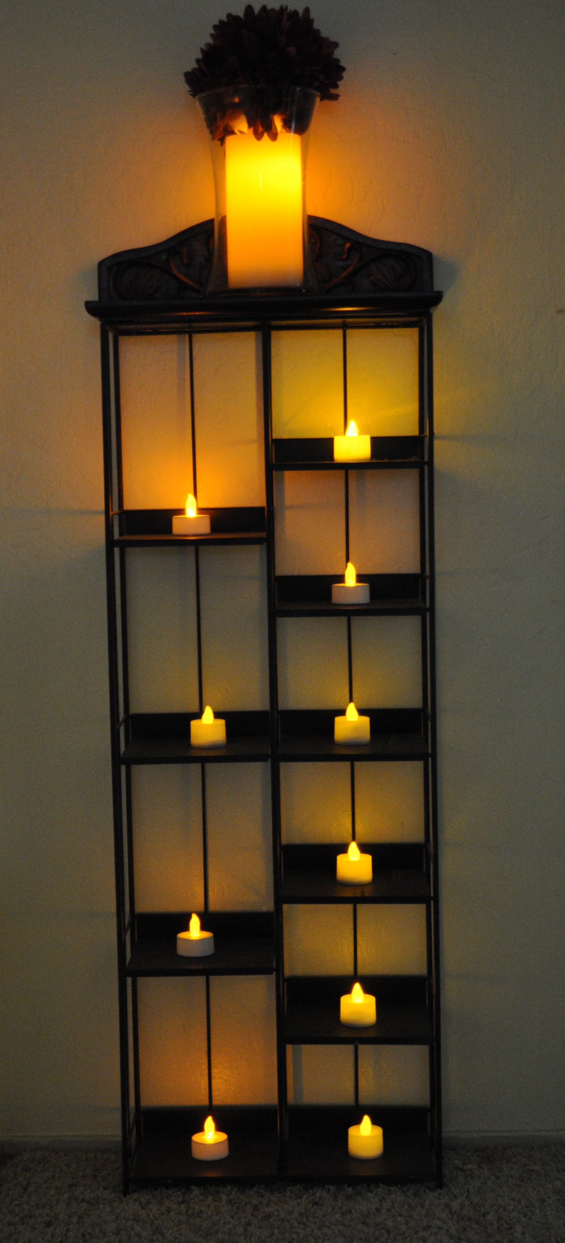 Old cd tower rack re purposed for holding candles 500eco - Cd storage rack tower ...